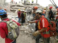 Scouts clearing the rubble in Mexico